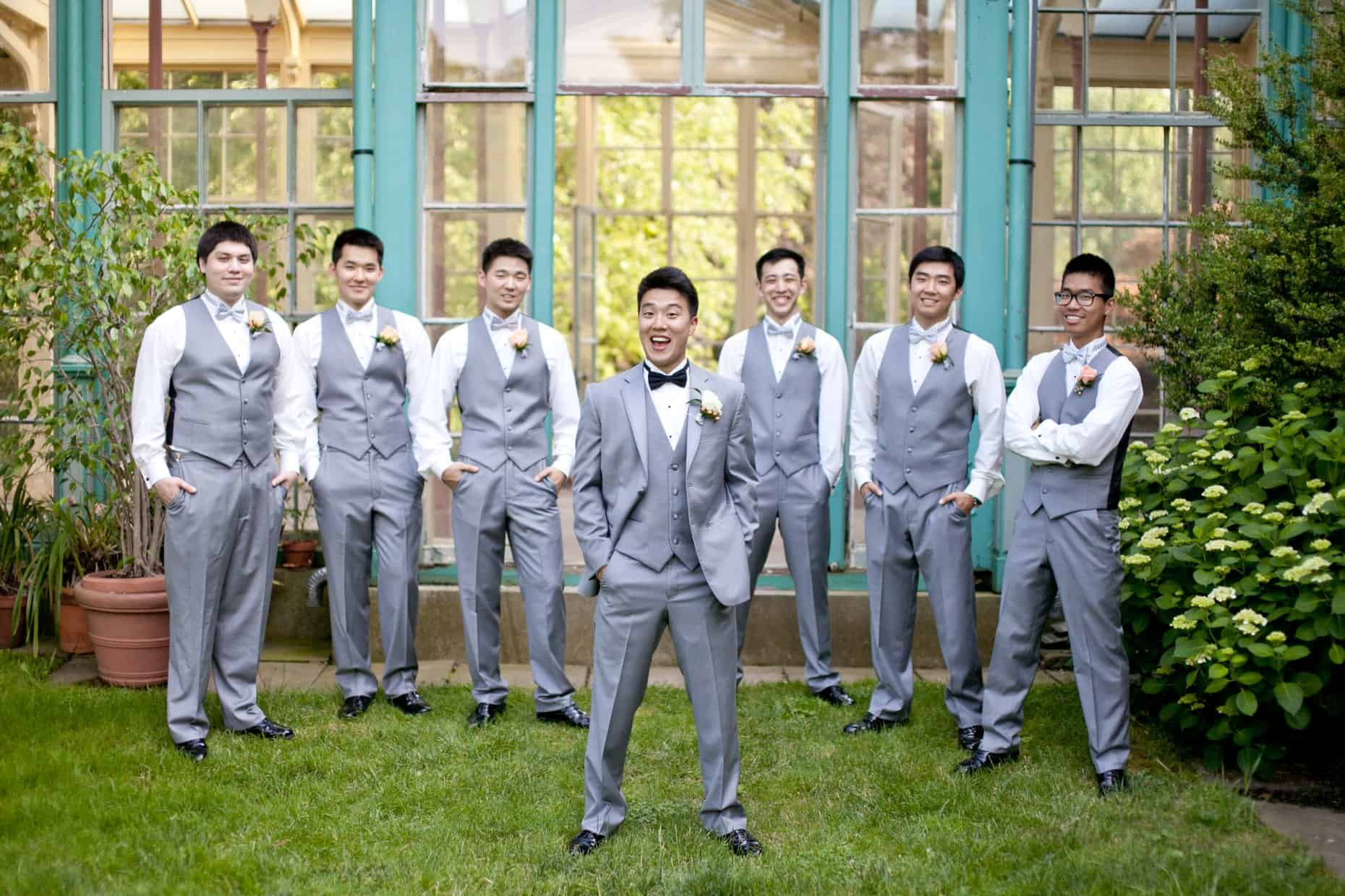 Groom with groomsman in front of the mansion at Rockwood Carriage House