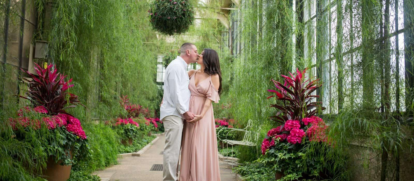 engagement session kissing at Longwood Gardens