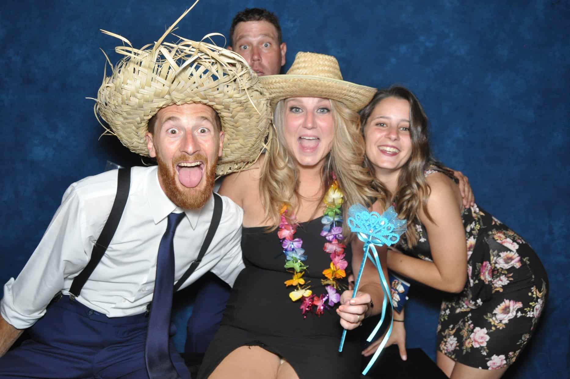photo booth picture with straw hats and wand prop