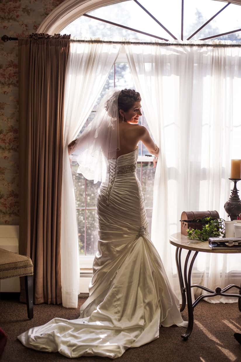 Bridal gown backlit at Penn Oaks Country Club