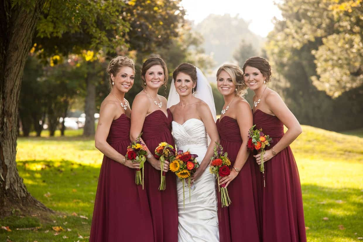 Bridesmaids holding fall bouquets at Penn Oaks Country Club