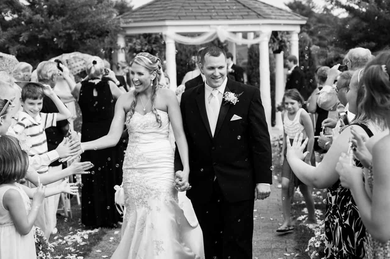 Bride and groom walking out of ceremony at Penn Oaks Country Club